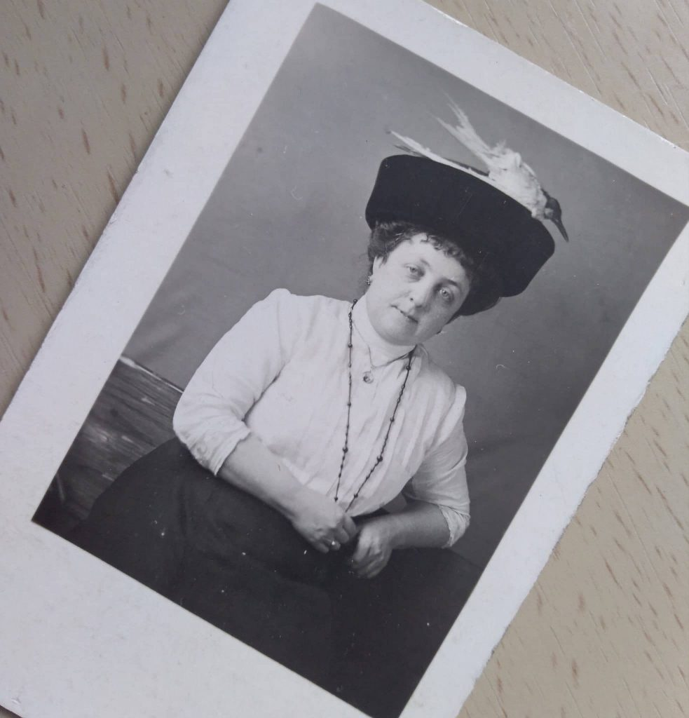 1910c. lady and hat with bird